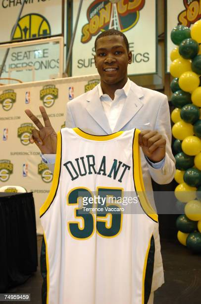 Kevin Durant of the Seattle SuperSonics holds up his new jersey during a press conference held at the Furtado Center June 29 2007 in Seattle...