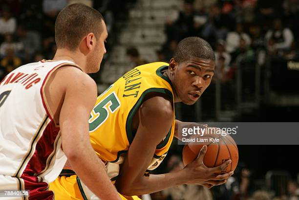 Kevin Durant of the Seattle SuperSonics is defended by Sasha Pavlovic of the Cleveland Cavaliers on January 8 2008 at The Quicken Loans Arena in...