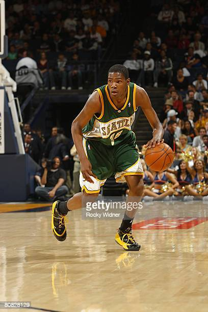 Kevin Durant of the Seattle SuperSonics moves the ball during the NBA game against the Golden State Warriors on April 16 2008 at Oracle Arena in...
