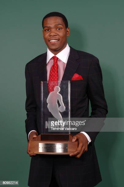 Kevin Durant of the Seattle SuperSonics poses with the Eddie Gottlieb Trophy awarded in honor of his selection as the 200708 TMobile Rookie of the...