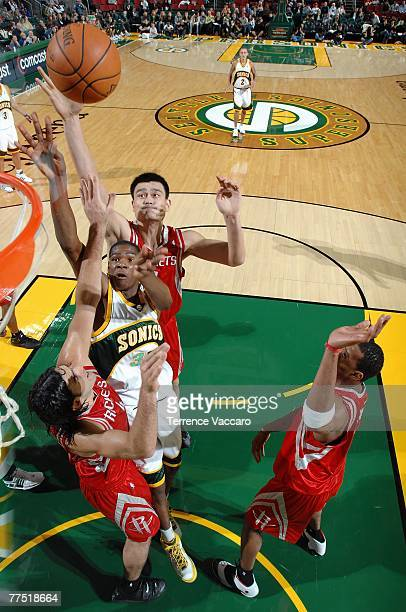 Kevin Durant of the Seattle SuperSonics puts a shot up over Yao Ming Tracy McGrady and Luis Scola of the Houston Rockets during the game at Key Arena...