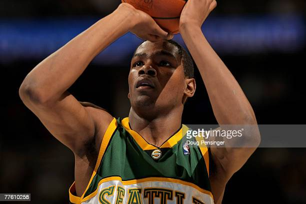 Kevin Durant of the Seattle SuperSonics takes a free throw against the Denver Nuggets in his NBA debut at the Pepsi Center on October 31 2007 in...