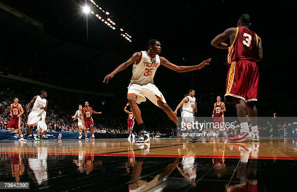 Kevin Durant of the Texas Longhorns defends against Lodrick Stewart of the USC Trojans during the second round of the NCAA Men's Basketball...