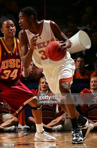 Kevin Durant of the Texas Longhorns dribbles the ball against Gabe Pruitt of the USC Trojans during the second round of the NCAA Men's Basketball...
