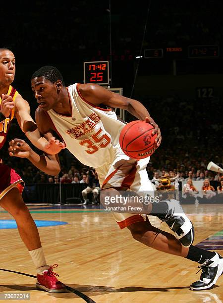 2a4c3cb4113 Kevin Durant of the Texas Longhorns dribbles the ball against the USC  Trojans during the second