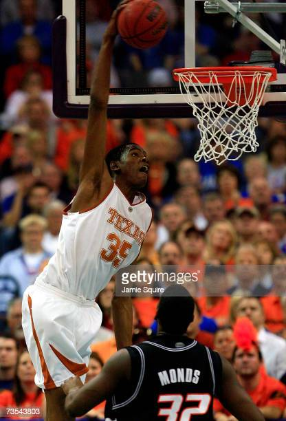 Kevin Durant of the Texas Longhorns dunks over David Monds of the Oklahoma State Cowboys during the semifinal game of the Phillips 66 Big 12 Men's...