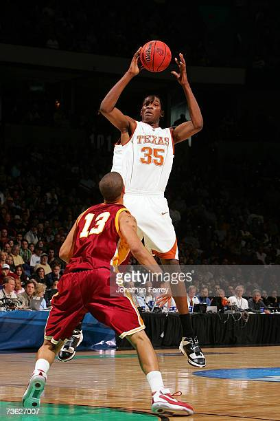Kevin Durant of the Texas Longhorns jumps to control the ball over Daniel Hackett of the USC Trojans during the second round of the NCAA Men's...