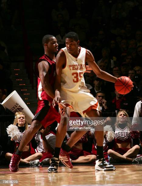 2dbacac64f5 Kevin Durant of the Texas Longhorns posts up David Fisher of the New Mexico  State Aggies