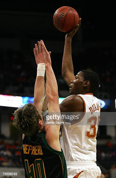 Kevin Durant of the Texas Longhorns shoots over Mark Shepherd of the Baylor Bears during the quarterfinal game of the Phillips 66 Big 12 Men's...