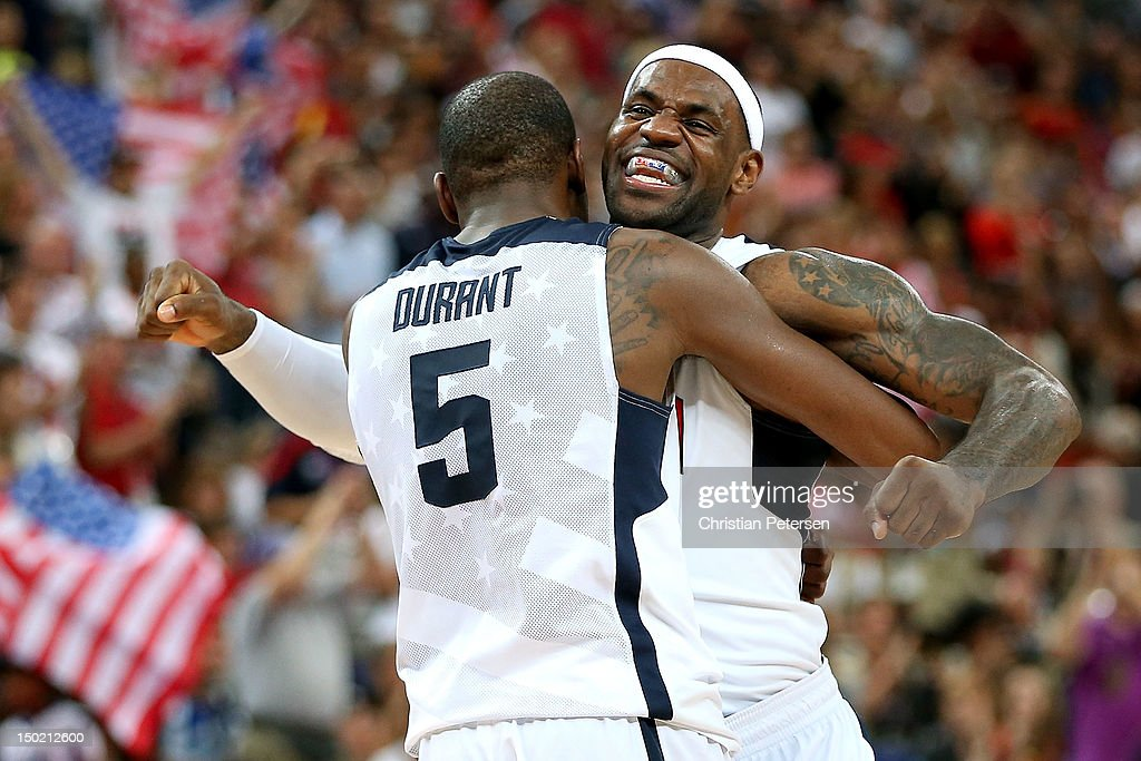 Kevin Durant #5 of the United States and team mate LeBron James #6 of the United States celebrate in the Men's Basketball gold medal game between the United States and Spain on Day 16 of the London 2012 Olympics Games at North Greenwich Arena on August 12, 2012 in London, England.