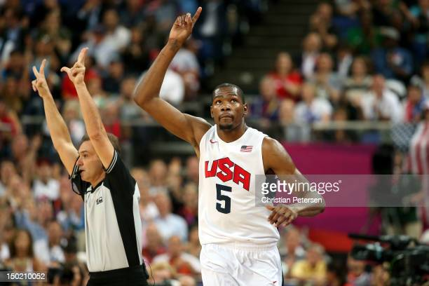 Kevin Durant of the United States celebrates making a three point shot during the Men's Basketball gold medal game between the United States and...