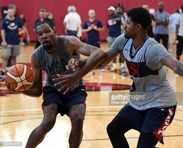 Kevin Durant of the United States drives against Paul George of the United States during a practice session at the 2018 USA Basketball Men's National...