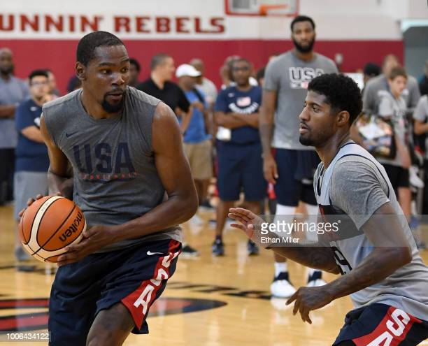 Kevin Durant of the United States is guarded by Paul George of the United States during a practice session at the 2018 USA Basketball Men's National...