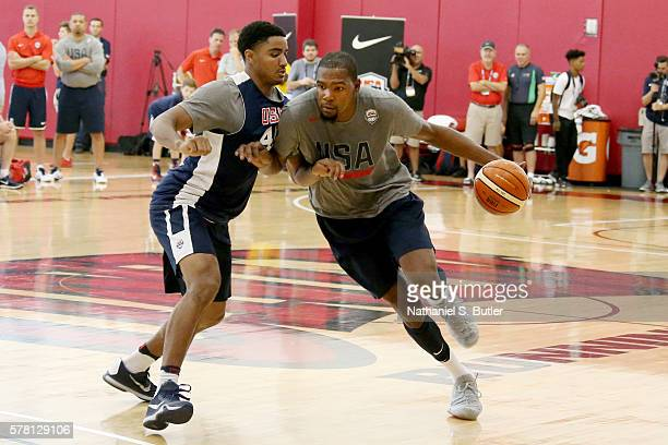 Kevin Durant of the USA Basketball Men's National Team drives to the basket against Gary Harris of the USA Basketball Mens Select Team during...