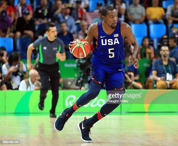 Kevin Durant of the USA dribbles the ball during the Men's Gold medal game between Serbia and the USA on Day 16 of the Rio 2016 Olympic Games at...
