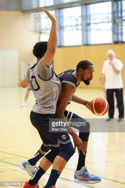 Kevin Durant of the USA Men's National Team handles the ball as Jayson Tatum of the USA Men's National Team plays defense during the USAB Men's...