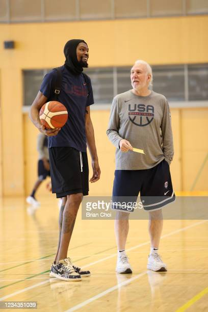 Kevin Durant of the USA Men's National Team talks with Head Coach Gregg Popovich of the USA Men's National Team during USAB Mens National Team...