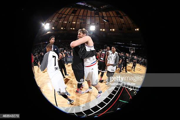 Kevin Durant of the Western Conference AllStar Team hugs Pau Gasol of the Eastern Conference AllStar Team after the 64th NBA AllStar Game presented...