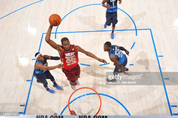 Kevin Durant of the Western Conference AllStars dunks against Paul Pierce of the Eastern Conference AllStars during the 2012 NBA AllStar Game on...