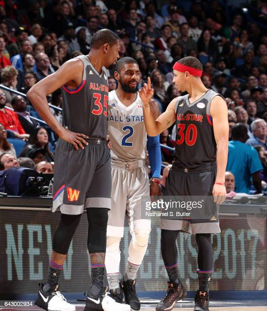 Kevin Durant of the Western Conference AllStars Stephen Curry of the Western Conference AllStars and Kyrie Irving of the Eastern Conference AllStars...
