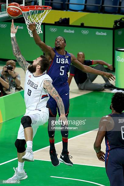Kevin Durant of United States blocks a shot by Miroslav Raduljica of Serbia during the Men's Gold medal game on Day 16 of the Rio 2016 Olympic Games...