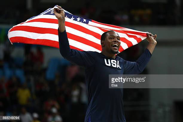 Kevin Durant of United States celebrates after defeating Serbia during the Men's Gold medal game on Day 16 of the Rio 2016 Olympic Games at Carioca...