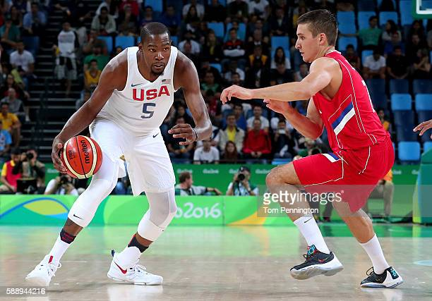 Kevin Durant of United States drives on Bogdan Bogdanovic of Serbia in the Men's Preliminary Round Group A match on Day 7 of the Rio 2016 Olympic...