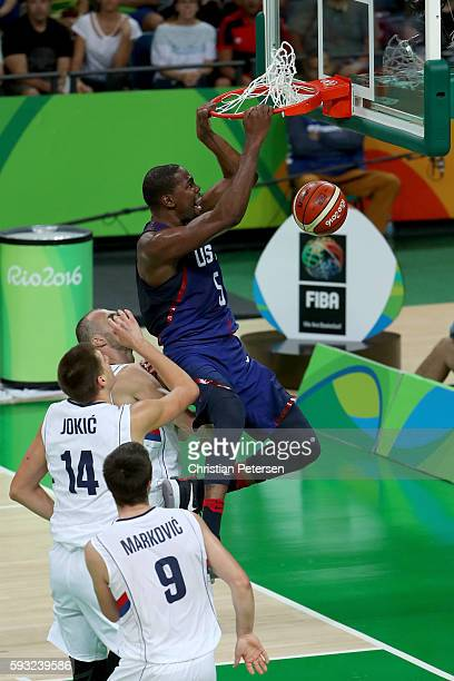 Kevin Durant of United States dunks the ball over Nikola Jokic of Serbia during the Men's Gold medal game on Day 16 of the Rio 2016 Olympic Games at...