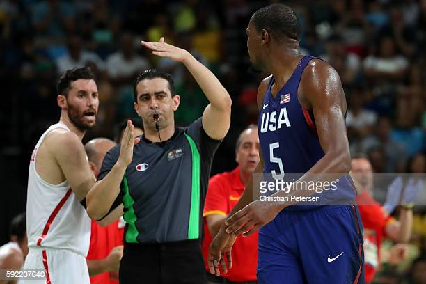 Kevin Durant of United States is given a technical foul by referee Guilherme Locatelli as Rudy Fernandez of Spain reacts during the Men's Semifinal...