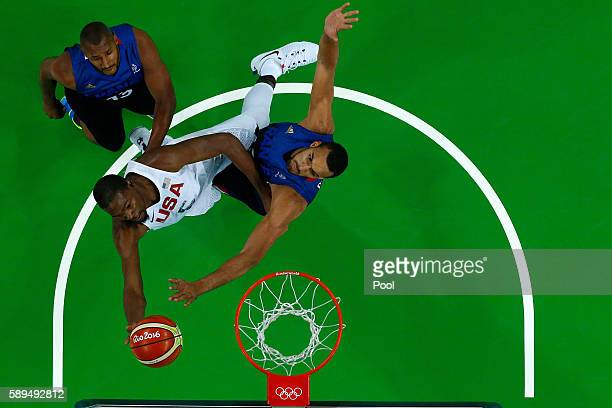 Kevin Durant of United States shoots against Rudy Gobert of France during a Men's Preliminary Round Group A game between the United States and France...