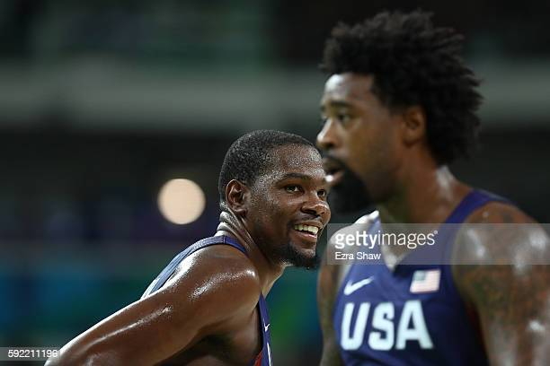 Kevin Durant of United States smiles on the court as DeAndre Jordan looks on during the Men's Semifinal match against Spain on Day 14 of the Rio 2016...