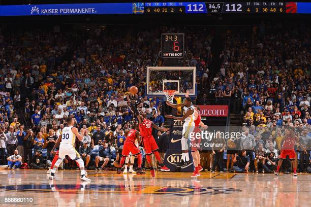 Kevin Durant passes the ball to Stephen Curry of the Golden State Warriors for the game winning shot against the Toronto Raptors on October 25 2017...