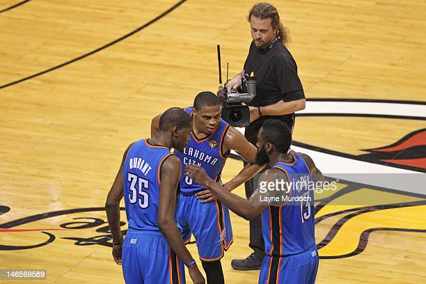 Kevin Durant Russell Westbrook and James Harden of the Oklahoma City Thunder talk strategy against the Miami Heat during Game Four of the 2012 NBA...