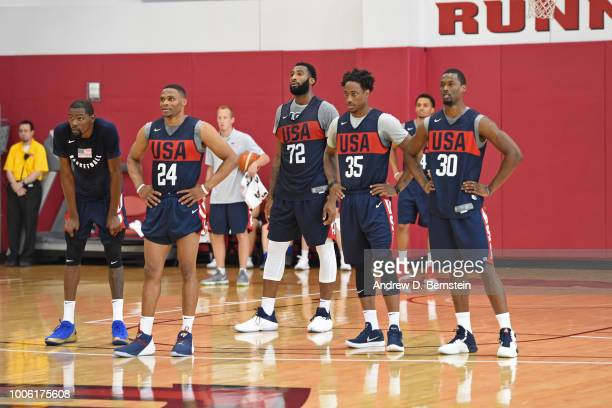 Kevin Durant Russell Westbrook Andre Drummond DeMar DeRozan and Harrison Barnes look on during USAB Minicamp Practice at Mendenhall Center on the...