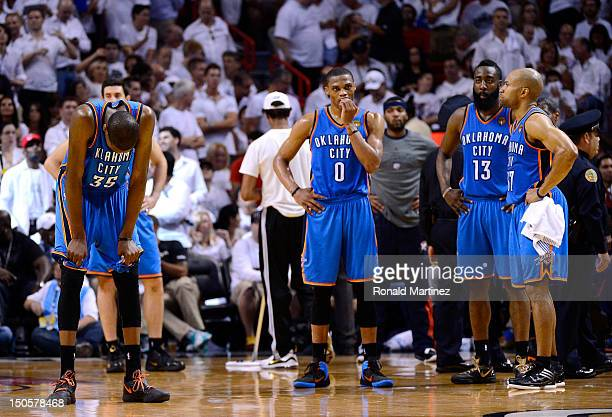 Kevin Durant Russell Westbrook James Harden and Derek Fisher of the Oklahoma City Thunder stand on court against Miami Heat in Game Five of the 2012...