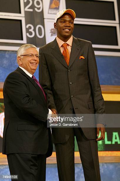 Kevin Durant shakes hands with NBA Commissioner David Stern after being selected second by the Seattle SuperSonics during the 2007 NBA Draft at the...
