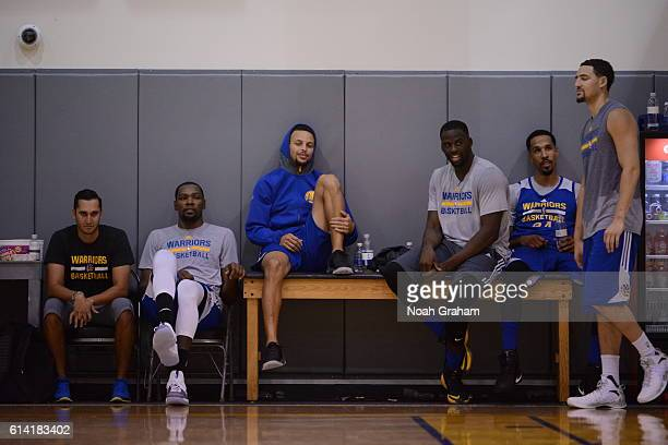 Kevin Durant Stephen Curry and Draymond Green and Shaun Livingston of the Golden State Warriors during practice on October 8 2016 at the Warriors...