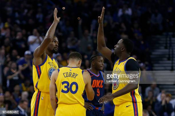 Kevin Durant Stephen Curry and Draymond Green of the Golden State Warriors celebrate during the game against the Oklahoma City Thunder at ORACLE...