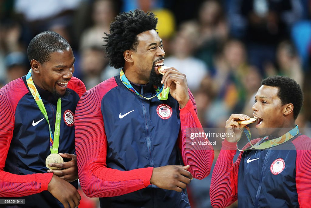 Kevin Durant,DeAndre Jordan and Kyle Lowry of the United States pose with their medals after the final match of the Men's basketball between Serbia and United States on day 16 at Carioca Arena 1 on August 21, 2016 in Rio de Janeiro, Brazil.