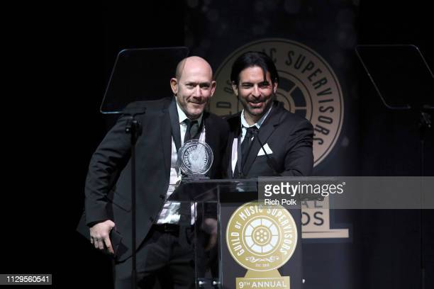 Kevin Edelman and John Ernst speak onstage during the 9th Annual Guild of Music Supervisors Awards on February 13 2019 at The Theatre at Ace Hotel in...