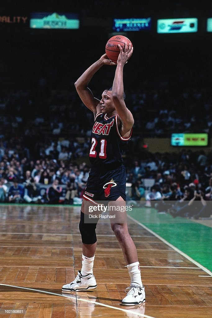 Kevin Edwards #21 of the Miami Heat passes against the Boston Celtics during a game played in 1990 at the Boston Garden in Boston, Massachusetts.