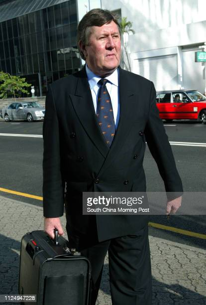Kevin Egan leaves Wan Chai District Court after testifying for the charges on conspiracy to pervert the course of justice, Wan Chai. 10 May 2006