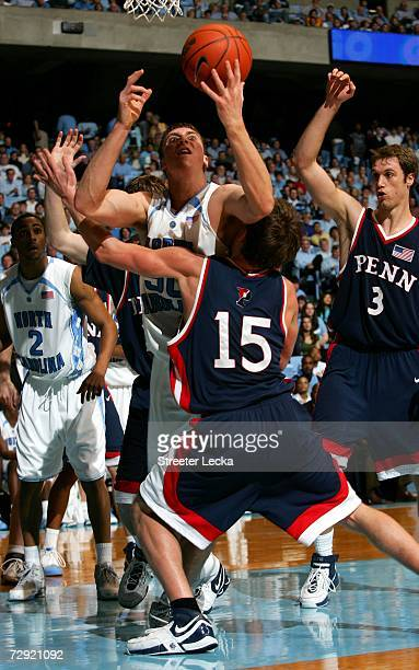 Kevin Egee of the Pennsylvania Quakers tries to stop Tyler Hansbrough of the University of North Carolina Tar Heels on January 3 2006 at the Dean...