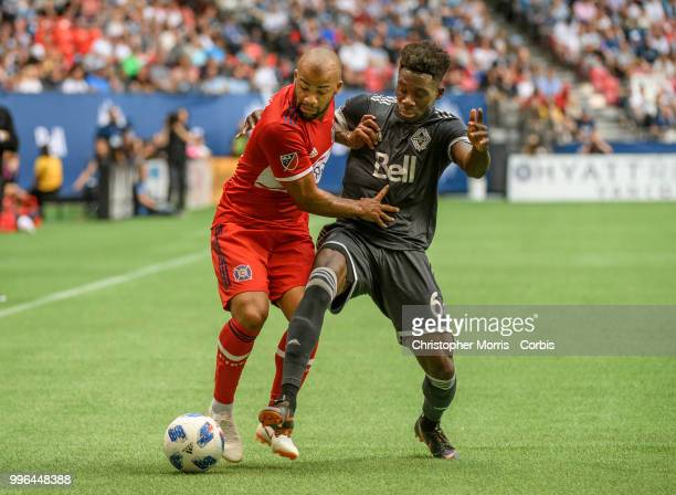 Kevin Ellis of the Chicago Fire and Alphonso Davies of the Vancouver Whitecaps FC at BC Place on July 7 2018 in Vancouver Canada