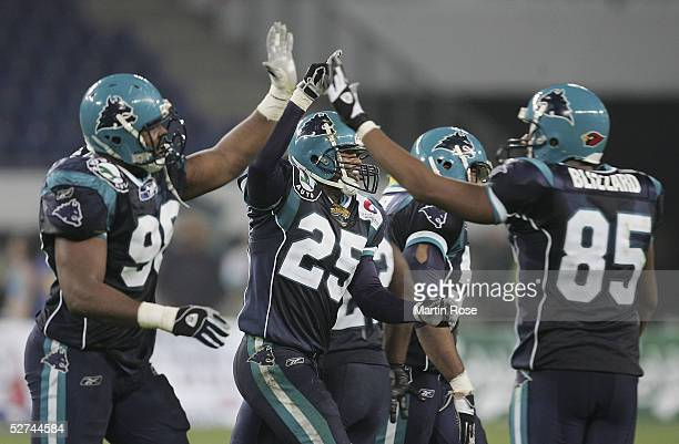 Kevin Emanuel, Marcell Allmond and Bobby Blizzard of Hamburg celebrates scoring the first touchdown during the NFL Europe match between Hamburg Sea...