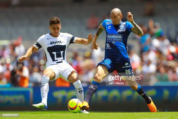 Kevin Escamilla of Pumas and Jorge Enriquez of Puebla fight for the ball during the 15th round match between Pumas UNAM and Puebla as part of the...