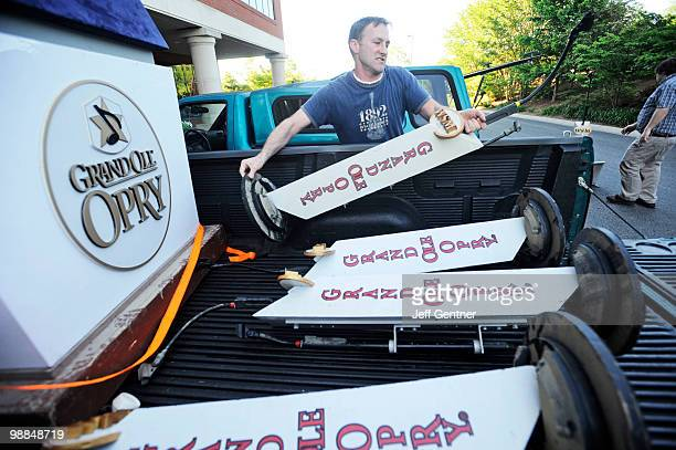 Kevin Farrell loads microphone stands into a truck from the Grand Ole Opry on May 4 2010 in Nashville Tennessee More than 13 inches of rain fell over...