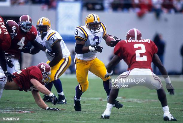 Kevin Faulk of the LSU Tigers runs with the ball as Deshea Townsend of the Alabama Crimson Tide goes for the tackle on November 8 1997 at BryantDeny...