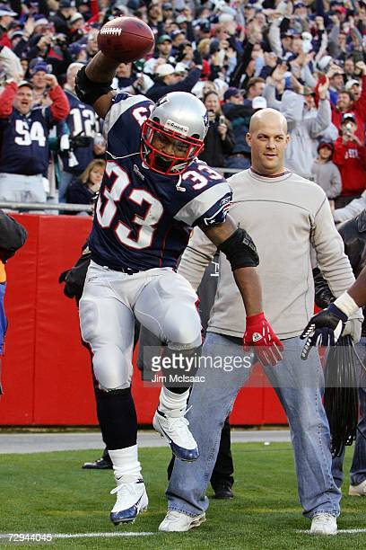 Kevin Faulk of the New England Patriots celebrates his touchdown run in the fourth quarter against the New York Jets during the AFC Wild Card Playoff...
