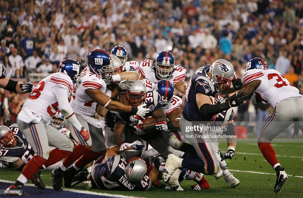 Kevin Faulk #33 of the New England Patriots is tackled by the New York Giants defense at the goal line during Super Bowl XLII on February 3, 2008 at University of Phoenix Stadium in Glendale, Arizona. The Giants defeated the Patriots 17-14.